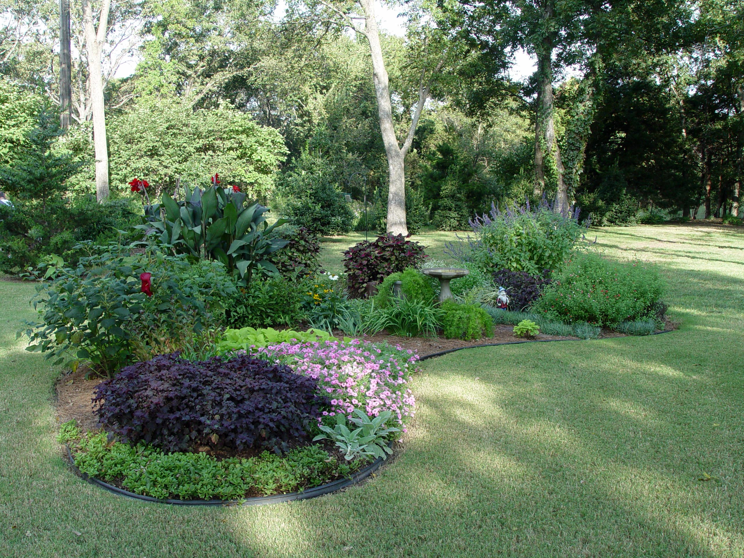Down sizing the lawn garden housecalls for Landscape bed design