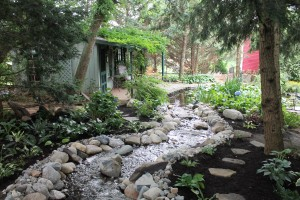 """The stream and """"writer's cottage"""" in the back yard of the Houseal/Housel residence."""