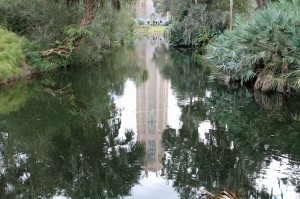 Bok Tower reflecting in a garden pond.