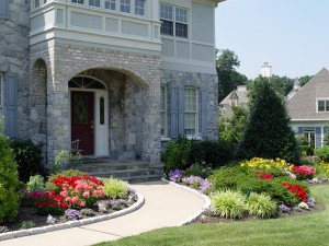 Wider foundation beds mean more plants and more variety, as the Coopers display here in their Hershey front yard.