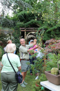 PHS Gold Medal Plant committee member Michael Colibraro shows visitors around his home garden near Philadelphia.