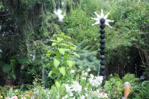 One of Buffalo's best-known garden focal points -- the bowling-ball totem pole.