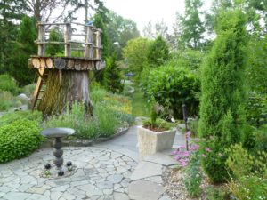 One of the many interesting sections of Jenny Rose Carey's home garden.