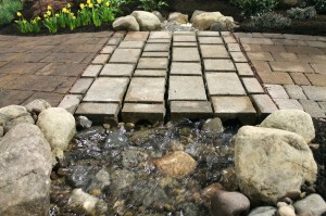 Water running through channels in the pavers at The Greenskeeper's display.