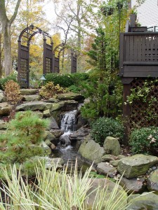 Hanselman Landscape turned this Lancaster County sloped, shaded side yard into a beautiful setting with arbors and a waterfall. turned this