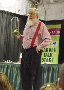 Roger Swain wielding a lawn sprinkler at the 2011 Pa. Garden Expo.