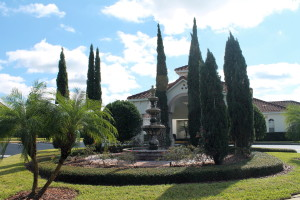 The fountain and clubhouse at the entrance to Tuscan Hills.