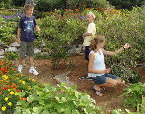 Here's a sight we don't see often enough... youngsters working in a garden.