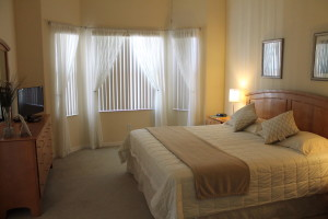 The master bedroom features its own TV and bathroom.