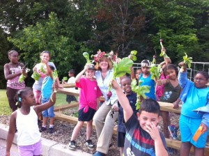Penn-Cumberland garden clubber Francesca McNichol showing Harrisburg school kids the joy of gardening.