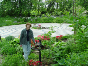 Ann Markley next to her landscaped labyrinth.