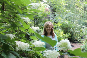 Kristin Livelsberger with one of her white hydrangeas.