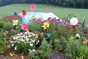 Jane and Larry Shull's garden with a van as an ornament is one of our home-garden stops in July 2017.