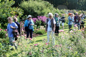 Rosamee Henrion, center, leads some of our tour group around her English perennial gardens.